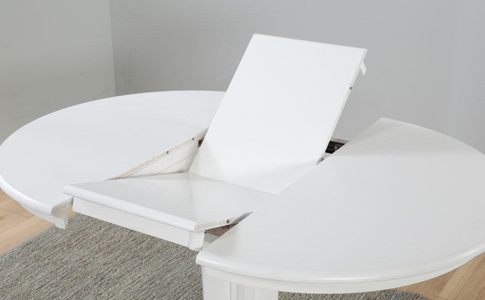 white round extendable dining table and chairs