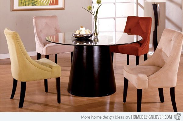dining table with different coloured chairs