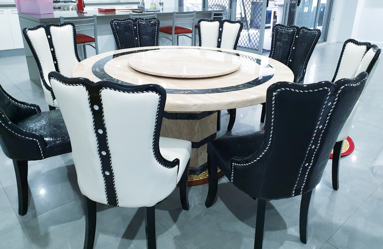 round cream dining table and chairs
