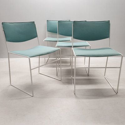 green and white dining chairs