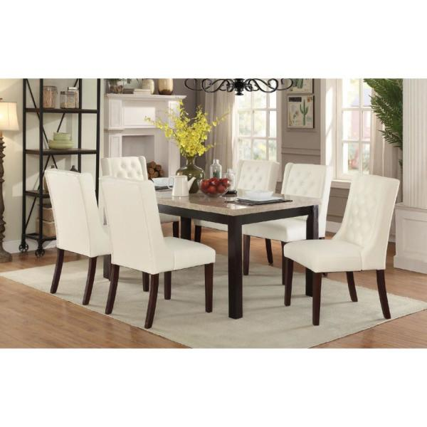 white cushioned dining chairs