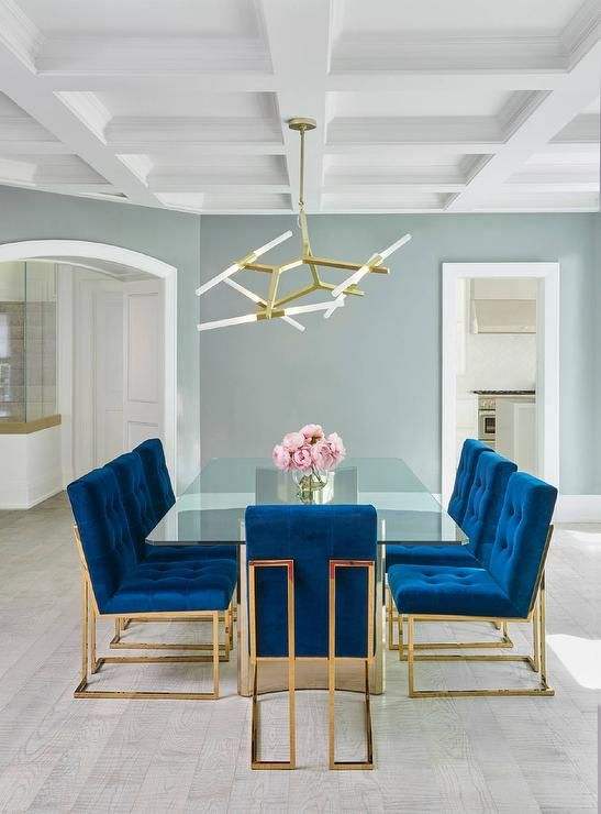 glass dining table with velvet chairs