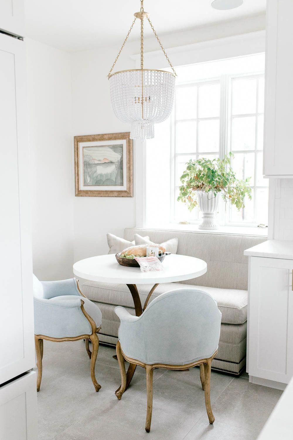 white dining table with bench seats