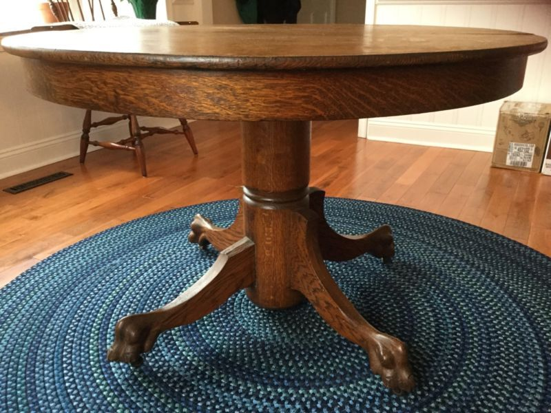 antique round oak dining table with claw feet