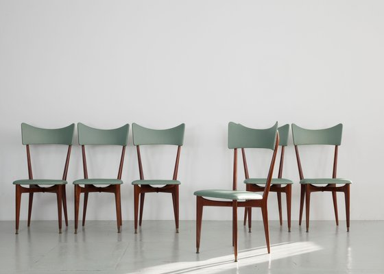 different colored dining chairs