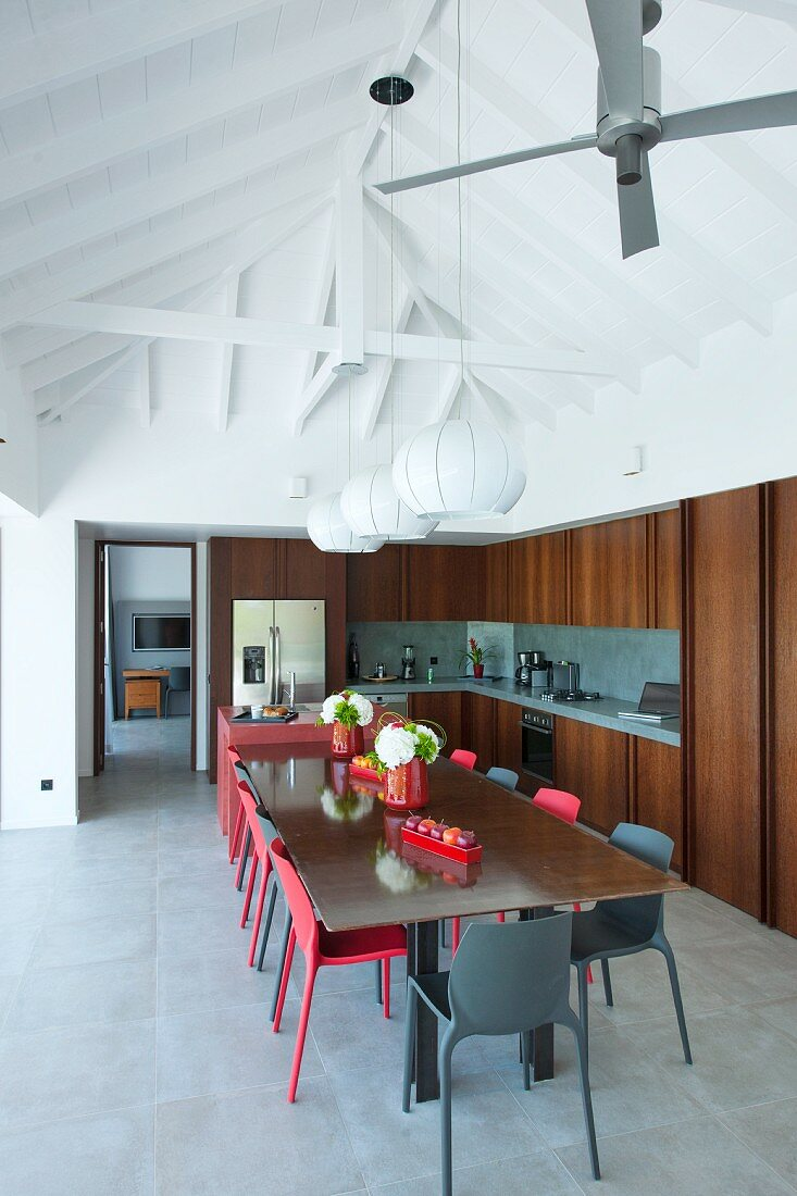 dining table with red chairs