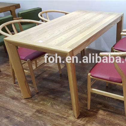 square wooden dining table and chairs