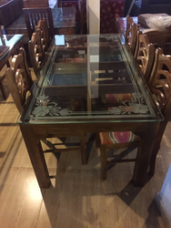 designer glass top dining table with pebbles