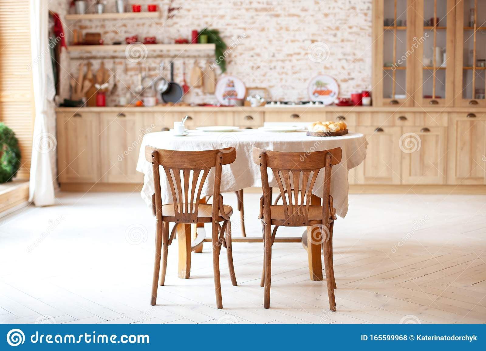Dining Room In A Cottage Style Brown Kitchen With A Round Rustic Dining Table With Chairs Outdoor Dining Room Interior With Kitc Stock Photo Image Of Living Apartment 165599968