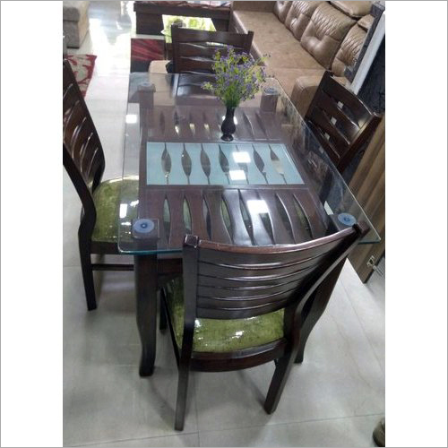 glass on wooden dining table