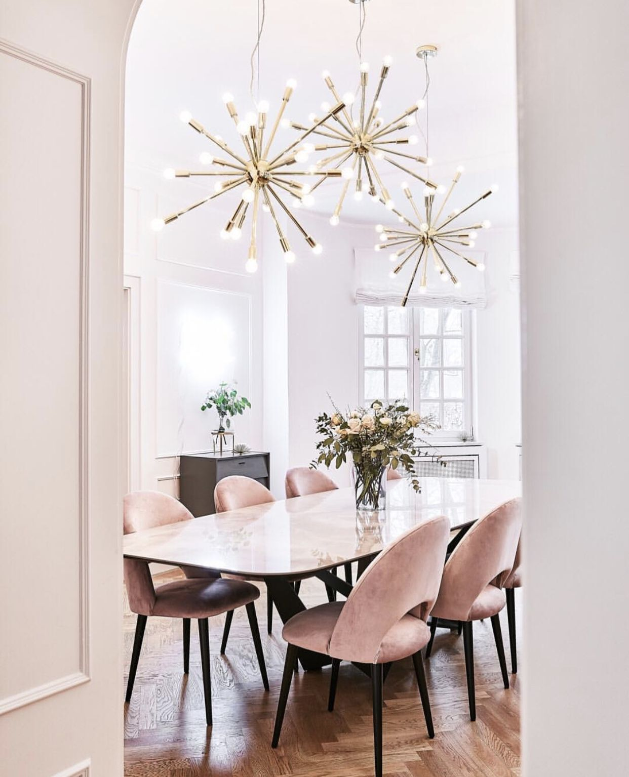 wooden dining table with velvet chairs