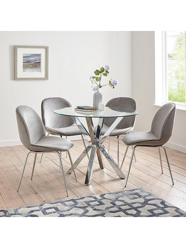 round dining table with velvet chairs