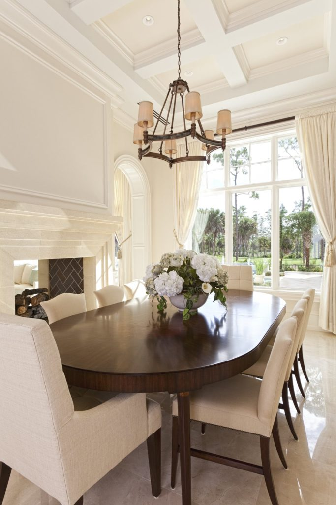 dark wood dining table with white chairs