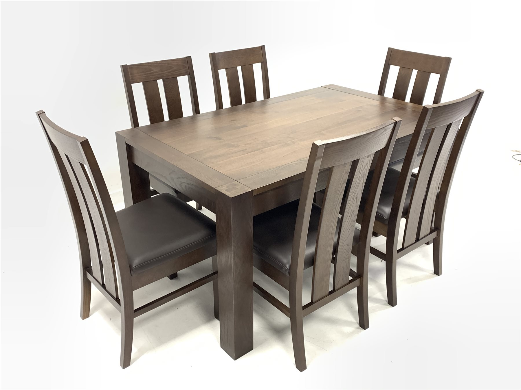 solid walnut dining table and chairs
