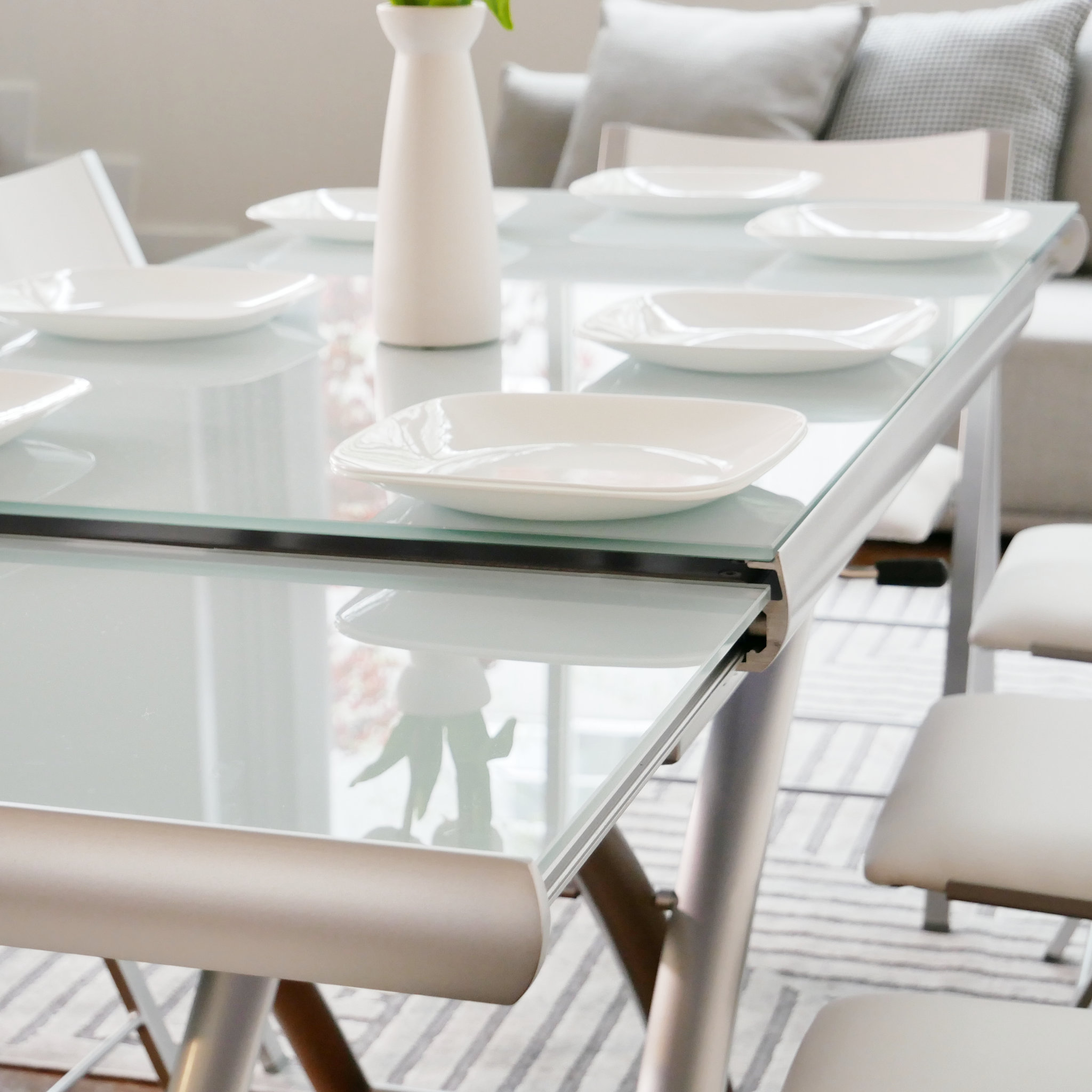 adjustable glass dining table