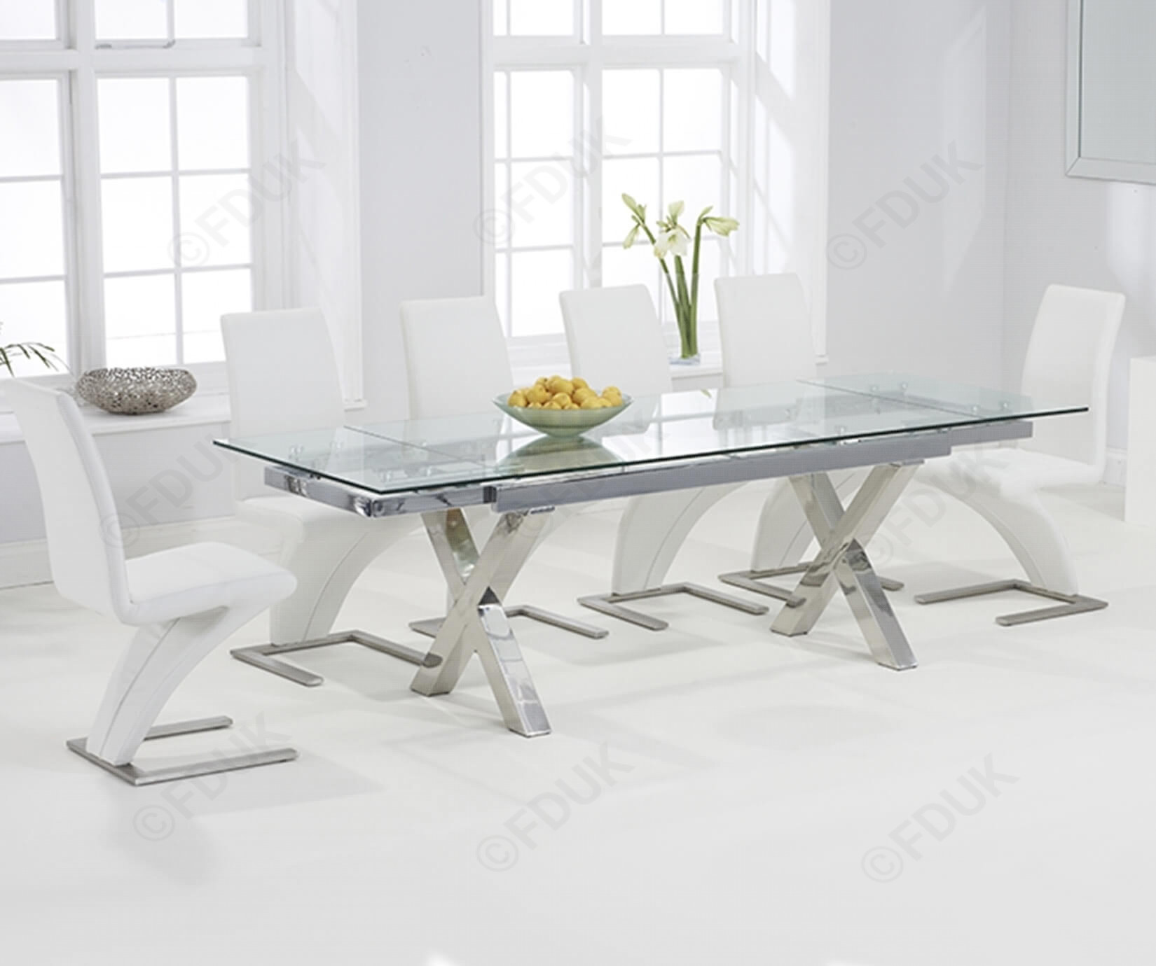 glass dining table with white chairs