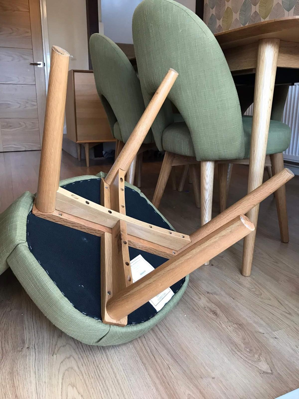 green upholstered dining chairs