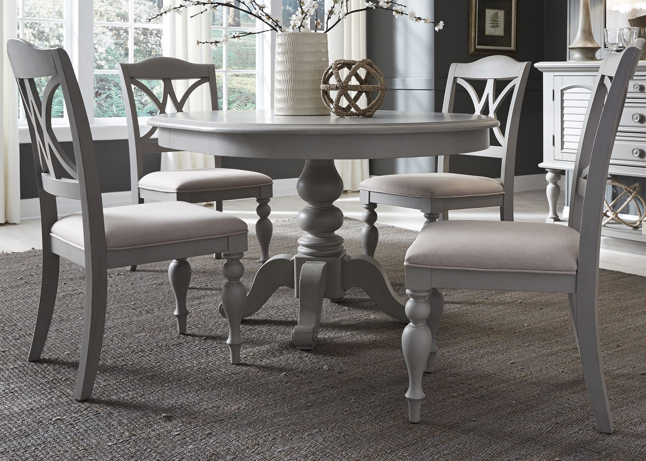 white round extendable dining table