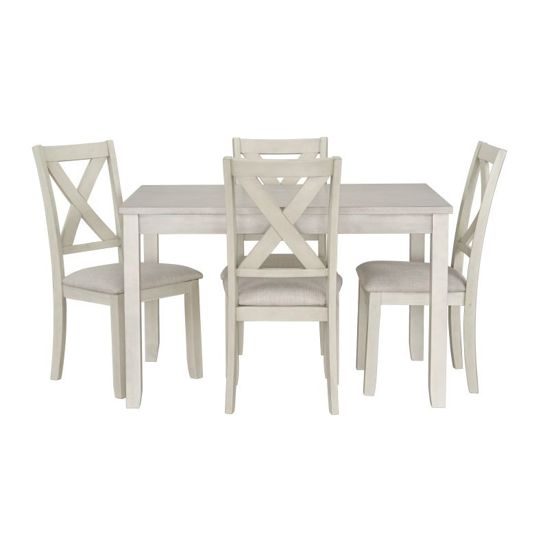 small white dining table and chairs