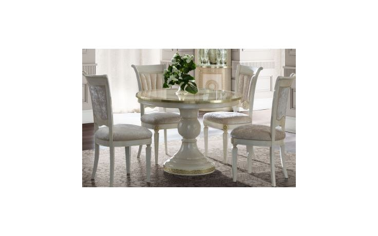 cream round dining table and chairs