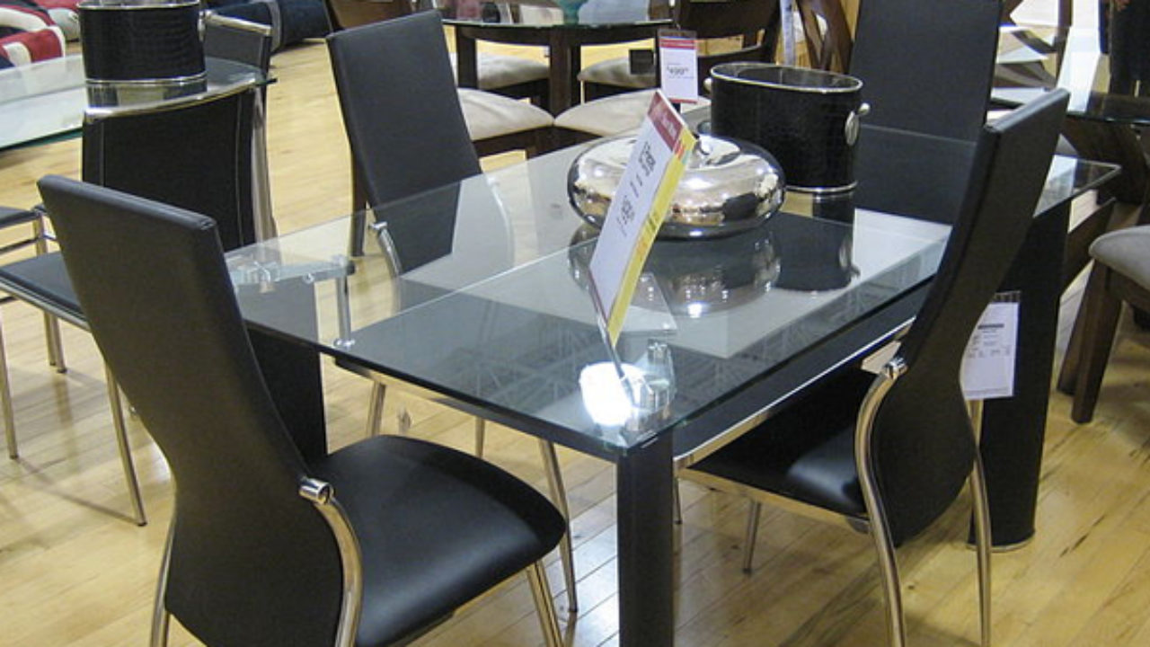 round glass and wood dining table and chairs